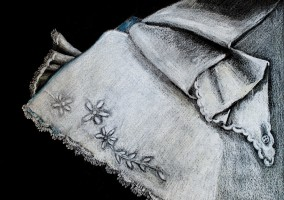Pencil crayon drawing of embroidered baby slip on black paper
